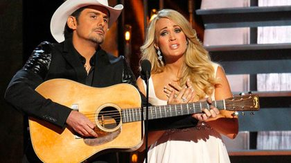 Carrie Underwood Surprises Brad Paisley Fans With Haunting 'Whiskey Lullaby' Duet