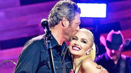 Blake Shelton & Gwen Stefani Share Sweet Thanksgiving Kiss In Adorable Snapshot