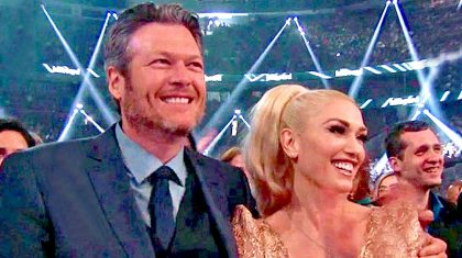 Blake Shelton Plants A Kiss On Gwen Stefani Following Big Award Win