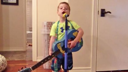 "Pint-Sized George Strait Fan Belts ""Carrying Your Love With Me"" At The Top Of His Lungs"