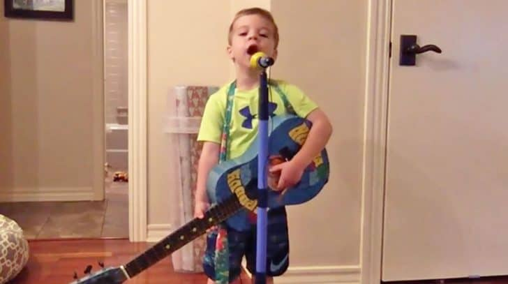 """Pint-Sized George Strait Fan Belts """"Carrying Your Love With Me"""" At The Top Of His Lungs 