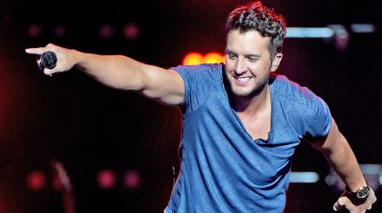 Luke Bryan Hysterically Calls Out Fan Holding Up A Blake Shelton Shirt At His Concert