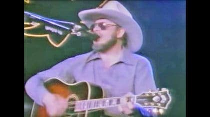 After Guitar String Breaks During Performance, Hank Jr. Proves How Much Of A Bad Ass He Is