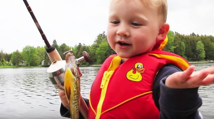 Little Boy's Reaction To Catching First Fish Will Have You Rolling With Laughter   Country Music Nation